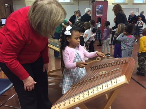 Trying the dulcimer