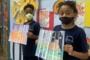 Travaris and Tenniyah display their artwork